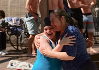 Chapel Hill mother and daughter, Ruth and Peri Thomson, hug following their jump into the frigid pool for UNC Special Olympics' Polar Plunge Fundraiser hosted at the Lark Chapel Hill pool on Saturday, March 2, 2019. Peri, 22, and has been swimming and cycling since the eighth grade.