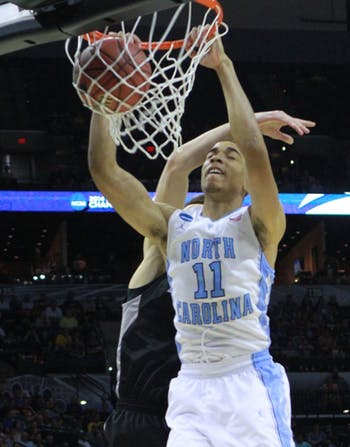 Brice Johnson dunks over a Providence player. UNC defeated Providence 79-77 in the second round of the NCAA tournament at the AT&T Center in San Antonio, TX. The Tar Heels advance to play in the third round on Sunday.