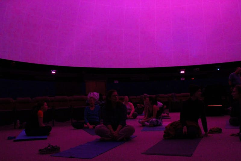 Carrboro Yoga Company hosts the Yoga Under the Stars event at Morehead Planetarium on January 30, 2019. The company hosted four yoga sessions that sold out almost immediately. The purple projection above will turn into images of stars and planets as participants take a 'journey through the universe.'