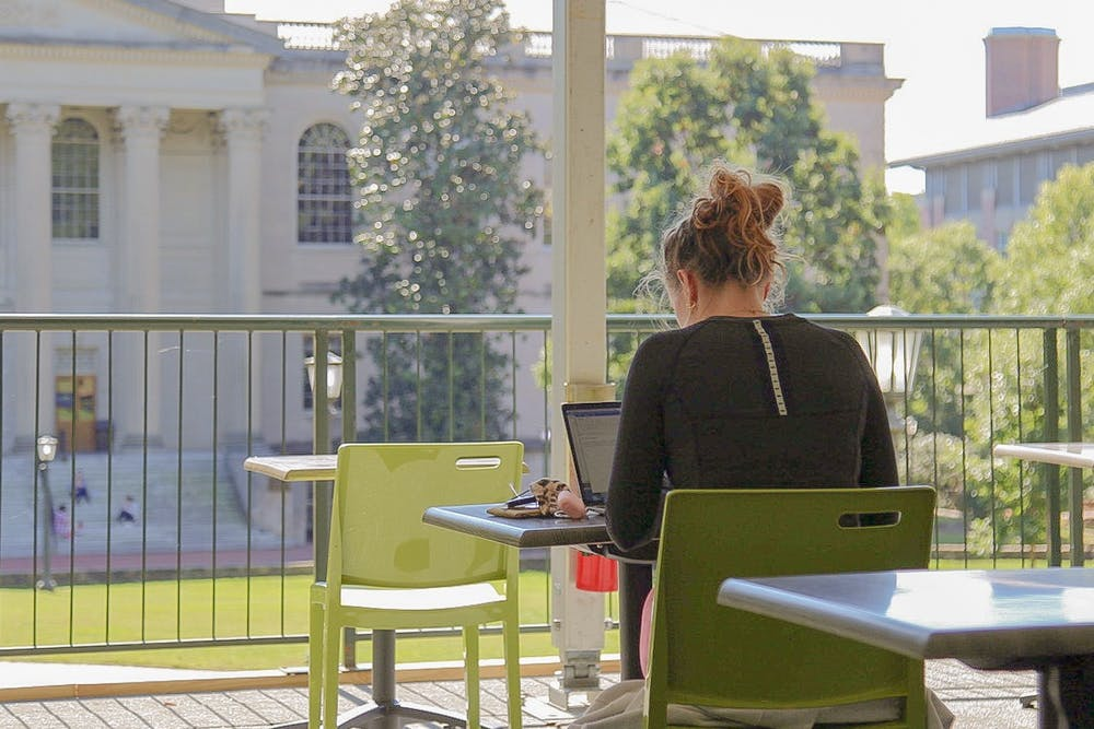 A student studies at the outdoor study space on the quad on Monday, Oct. 5, 2020.