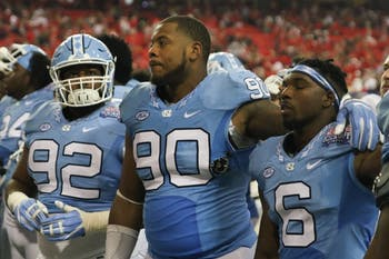 UNC defensive tackle Nazair Jones (90), and cornerback MJ stewart (6) show their disappointment after the team blows a ten point lead in the second half and falls to Georgia 33-24 in Atlanta on Saturday.