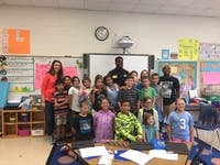 UNC senior safety J.K. Britt and other Tar Heel student-athletes read at elementary schools in Orange County on Oct. 10.