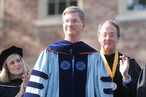 UNC Board of Governors Chair Hannah Gage and UNC President Erskine Bowles applaud Chancellor Holden Thorp during Sunday's University Day ceremony on Polk Place in 2008. The ceremony featured the presentation of distinguished alumni, remarks by community and state leaders, and the official installation of Thorp as the tenth chancellor of the University. An estimated 2,750 people attended the event.