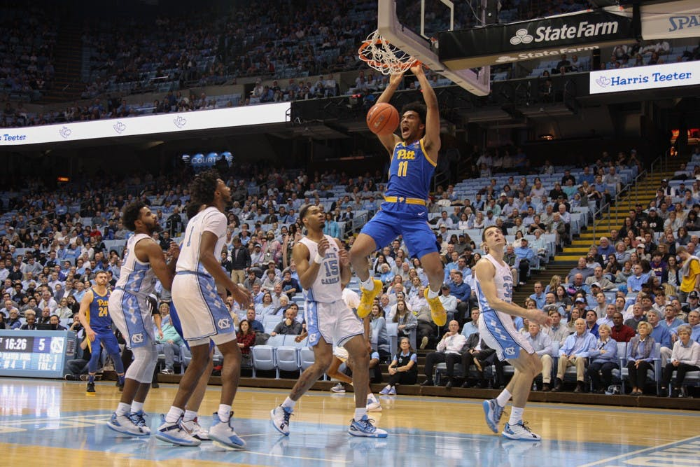 <p>Pitt forward Justin Champagnie (11) dunks the ball during the game on Wednesday Jan. 8, 2020. UNC lost to Pitt 65-73.&nbsp;</p>