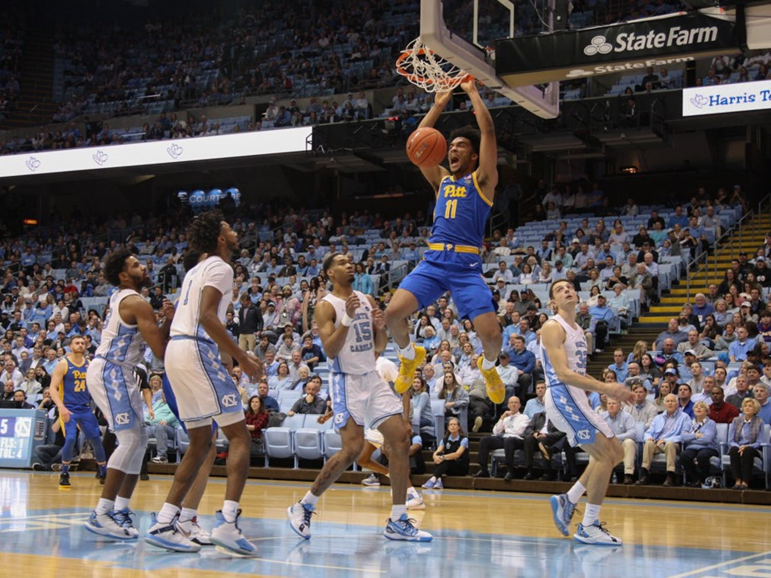 Pitt forward Justin Champagnie (11) dunks the ball during the game on Wednesday Jan. 8, 2020. UNC lost to Pitt 65-73.
