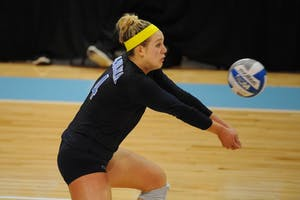UNC outside hitter Leigh Andrew (4) digs the ball.