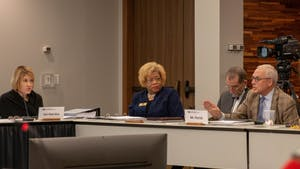 Vice-Chair Kellie Hunt Blue (left) and Seretary Pearl Burris-Floyd (middle left) observe as Committee Member R. Doyle Parrish (right) responds to aspects of a presented survey which collected data on various aspects of university faculty pay, retention, and participation across the UNC system and Historically Minority-serving institutions on Thursday, Jan. 24, 2019 at the UNC Center for School Leadership Development.