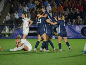 UNC women's soccer senior defender Julia Ashley is greeted by hugs from her teammates after scoring the game-winning goal against Georgetown in the College Cup semifinals on Nov. 30, 2018 at Sahlen's Stadium at WakeMed Soccer Park in Cary.