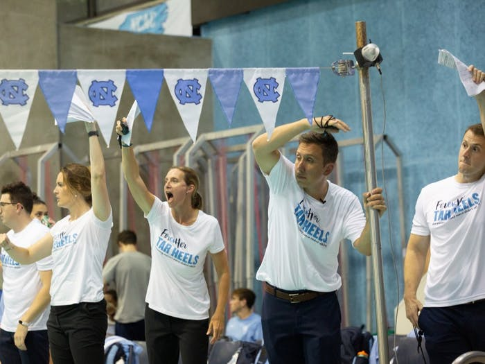 Mark Gangloff, UNC's head coach of the men's and women's swimming and diving programs, guides his team on Friday, Oct. 4, 2019 at his first meet as head coach. UNC claimed a victory over ECU at the Koury Natatorium in Chapel Hill.