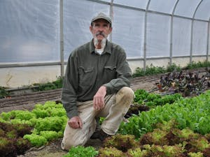 """Ken Dawson has been working on his farm, Maple Spring Gardens, for 36 years. He currently serves on the Orange County Food Council and is committed to providing local, organic produce to the Chapel Hill-Carrboro area. """"Raising food for the local community has been my life's work. The food council supports that work."""""""
