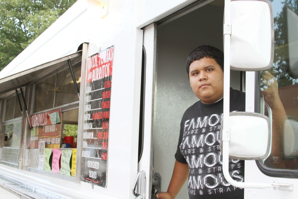 Roberto Garcia, 17, of Burlington works at the Taqueria Del Jalisco food truck located at 206 E. Main Street. The truck is open from 6pm-1am Tuesday to Saturday for late-night taco cravings.