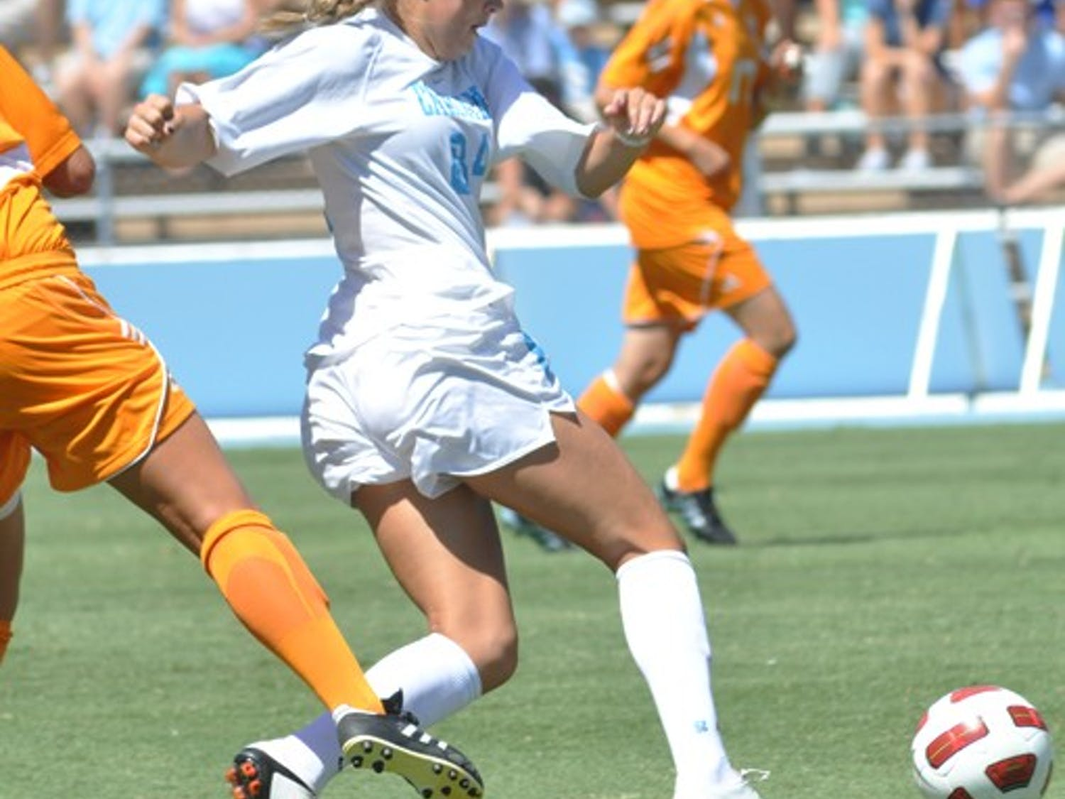 UNC junior forward Courtney Jones powers through a tackle. Jones was one of seven UNC players to score.