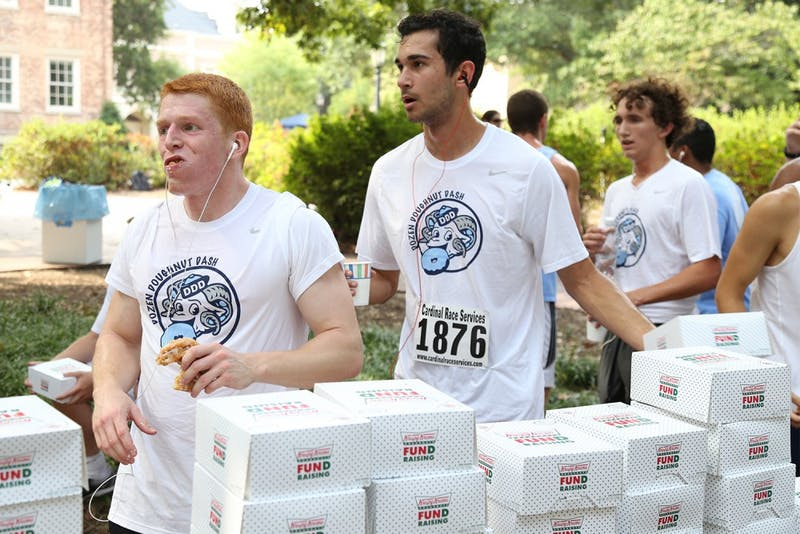 The Dozen Donut Dash began at the Old Well on Friday morning in September 2015. Participants had to run 2.5 miles before eating a dozen Krispy Kreme donuts and running another 1.5 miles. The race raises awareness and support for cancer patients.