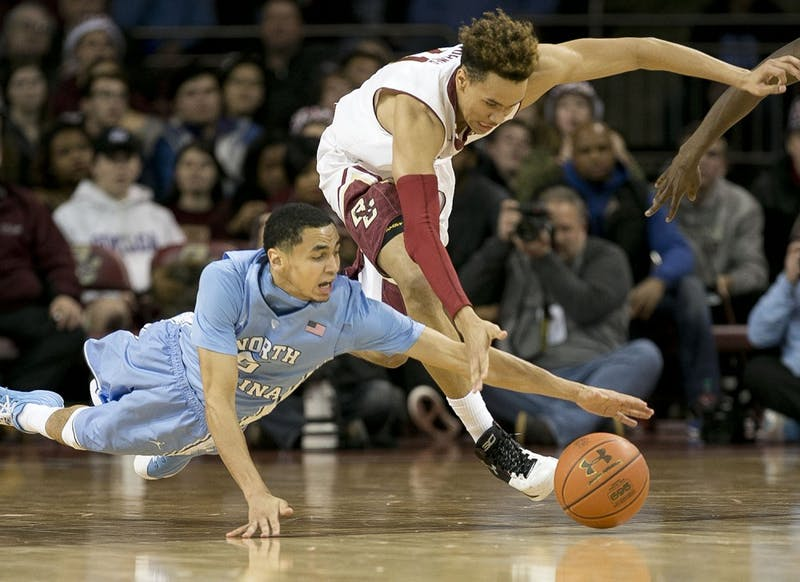 North Carolina's Marcus Paige (5) and Boston College's A.J. Turner (11) go after a loose ball in the first half on Tuesday, Feb. 9, 2016, at Conte Forum in Chestnut Hill, Mass. (Robert Willett/Raleigh News & Observer/TNS)