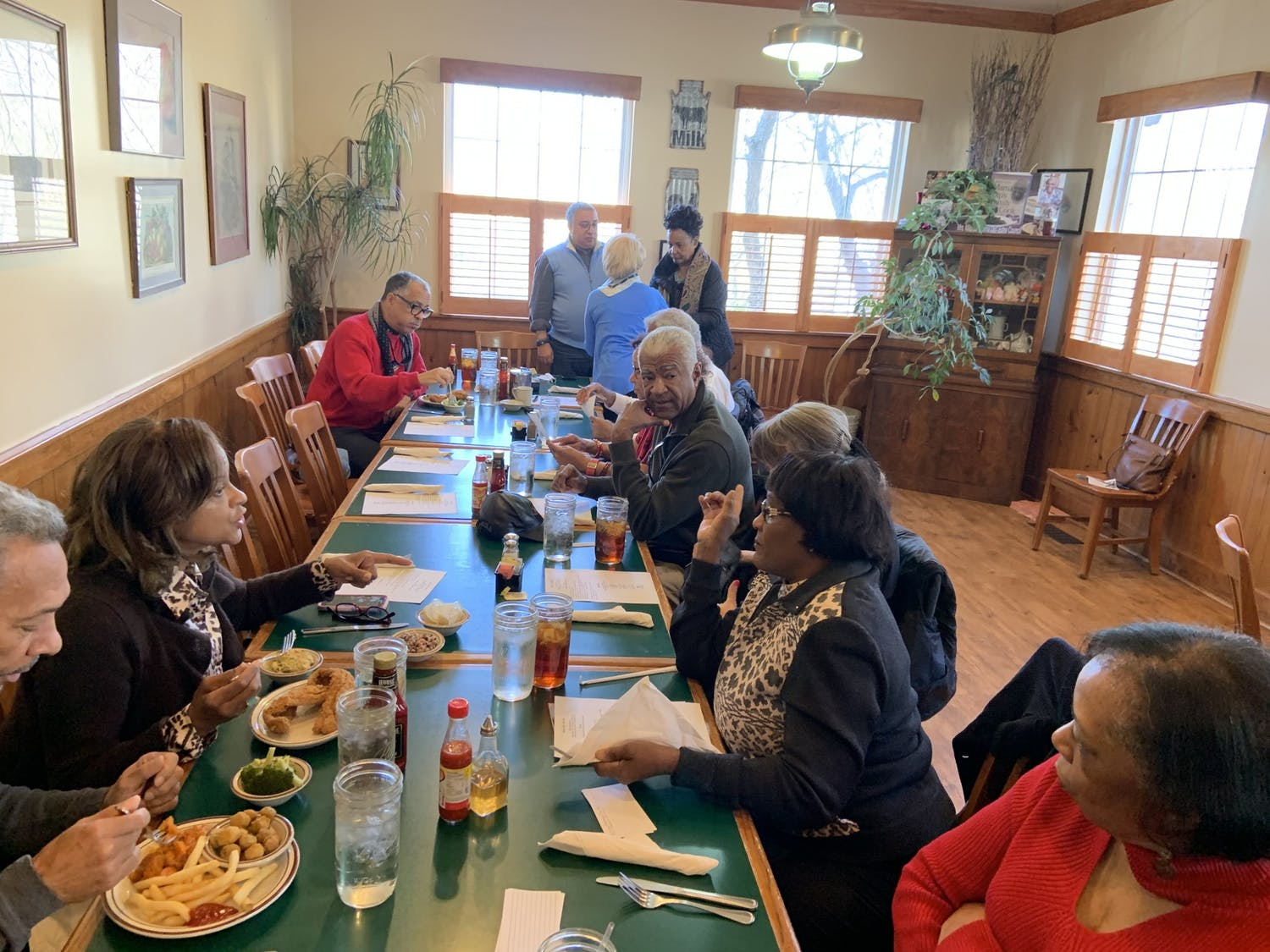 Some of the Black Pioneers and their spouses meet for lunch at Mama Dip's in early 2020. Photo courtesy of Walter A. Jackson.