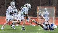 UNC first-year midfielder Zachary Tucci (35) goes for the ball Saturday, March 30, 2019 in the game against Duke at the UNC Lacrosse Stadium.