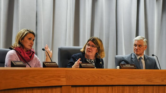 Chapel Hill Town Council members Jessica Anderson, Mayor Pam Hemminger, and Michael Parker vote during a meeting at Town Hall on Wednesday, Feb. 19, 2020.