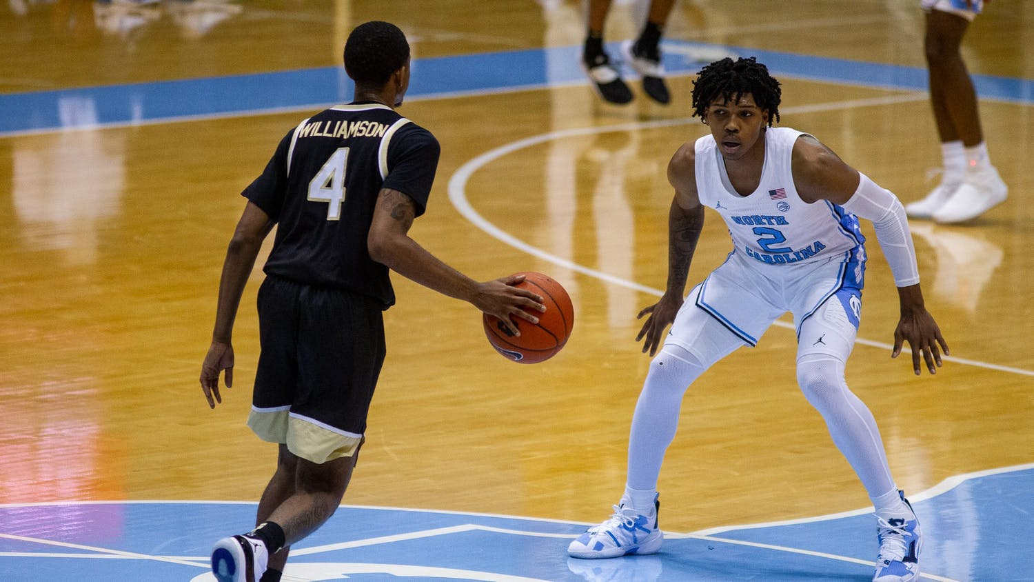 UNC freshman guard Caleb Love (2) defends against Wake Forest junior guard Daivien Williamson (4) in the Dean Smith Center Jan. 20, 2021. The Tar Heels beat the Demon Deacons 80-73.