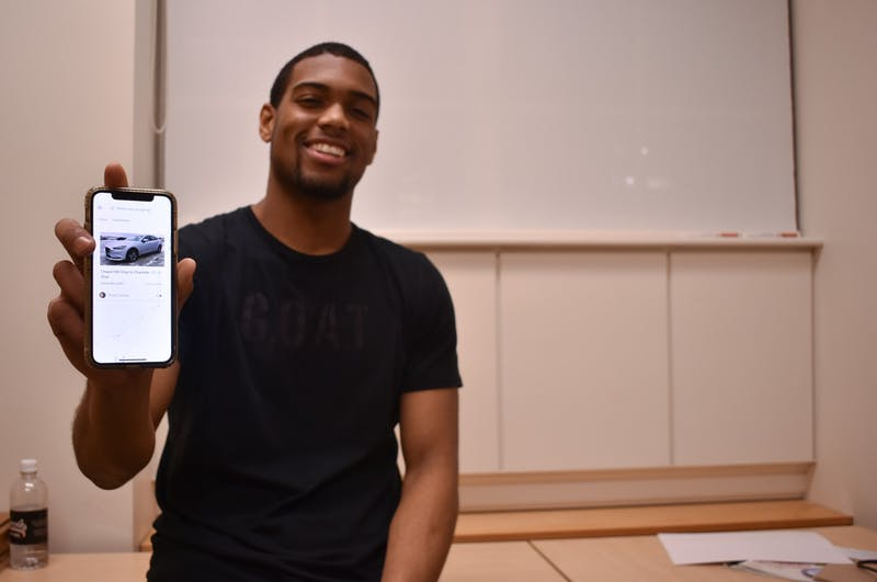 Junior Nehemiah Stewart poses for a portrait on Feb. 18, 2020 with his ride-sharing app, Vector Rideshare. The app, which he started developing in 2019, now allows university students around the country to carpool safely.