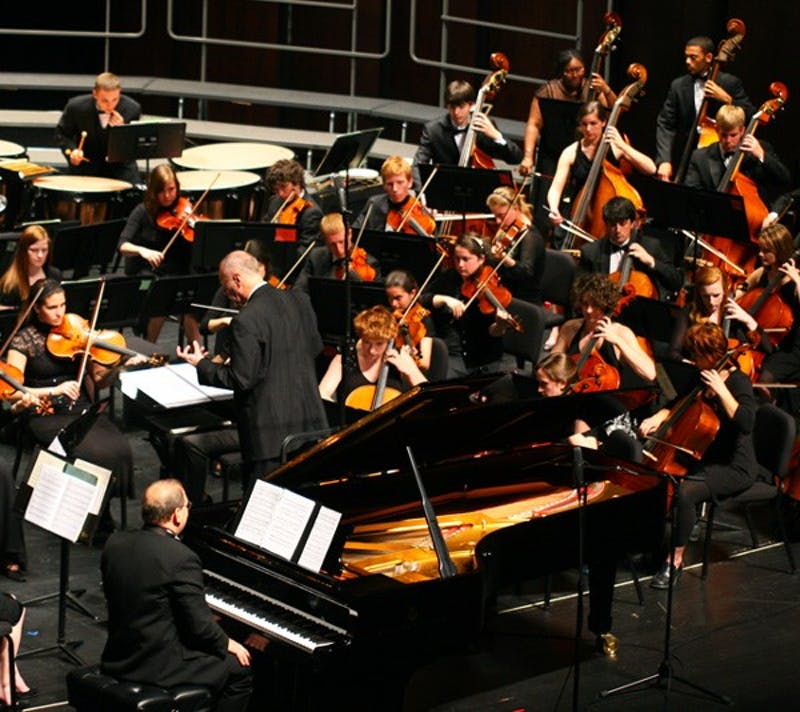 """UNC music professor Stephen Anderson (on the piano) premiered his original composition, """"Dysfunctional.""""  DTH/Daixi Xu"""