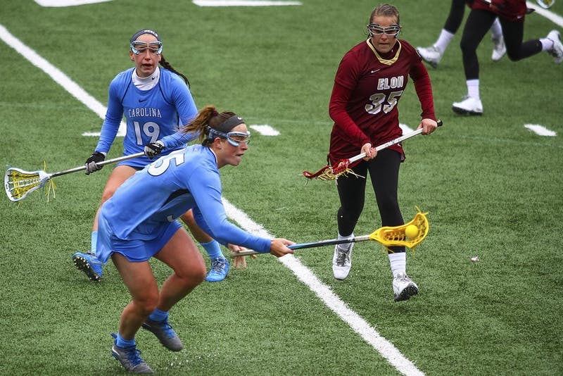 Senior defender Sarah Scott (19) chases the ball during the game against Elon on March 1. Scott had three fouls against Syracuse on Saturday, helping the Tar Heels defeat the Orange 15-8.