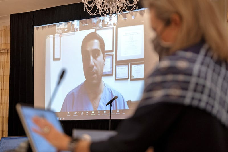 Dr. Amir Barzin addresses the board via Zoom during the UNC Board of Trustees full board meeting held at The Carolina Inn using COVID-19 protocols limiting the in-person attendance to 25 and having some participate via Zoom on Thursday, Nov. 12, 2020. Photo courtesy of Jon Gardiner.