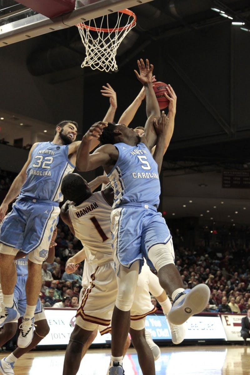 First-year Nassir Little (5) fights for rebound at Elon. UNC beat Elon 116-67 at the Schar Center at Elon.