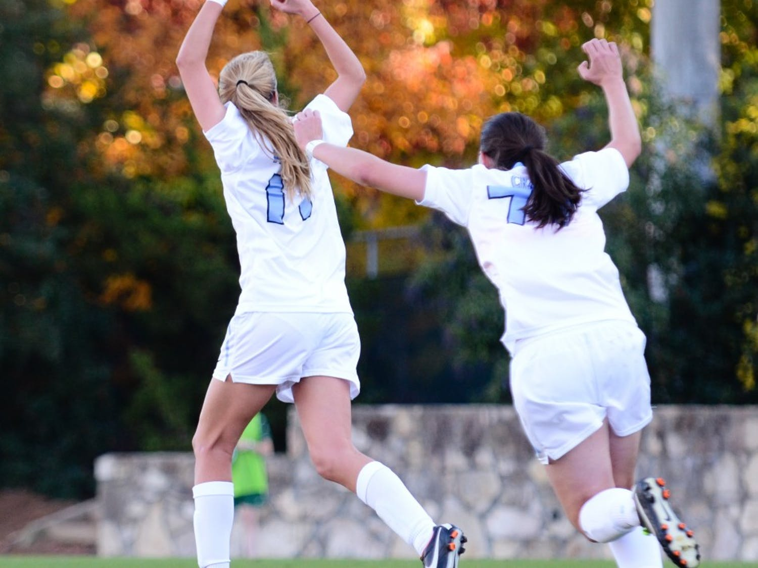 Kelly McFarlane (left) celebrates with teammate Rebecca Crabb (rigt). UNC defeated William and Mary 4-1 in the first round of the NCAA Tournament at Fetzer Field in Chapel Hill, NC.