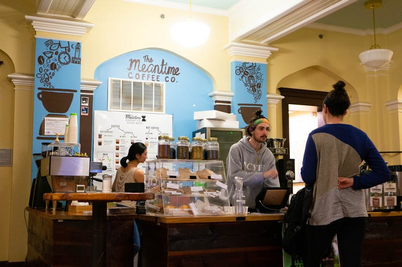 John Vance, a junior at UNC and barista at the student-run Meantime Coffee Company, enters a customer's order at the Campus Y on Thursday, Jan 16, 2020. 100% of profits from Meantime are going to help the wildfire crisis in Australia.