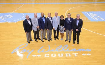 University officials pose with Roy Williams at the dedication of Roy Williams Court on Aug. 24. Photo courtesy of the UNC athletic department.