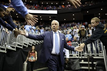 Head Coach Roy Williams high-fives fans as he enters the arena for the second round of the NCAA tournament against Washington at Nationwide Arena in Columbus, OH on Sunday, March 24, 2019. UNC defeated Washington 81-59.