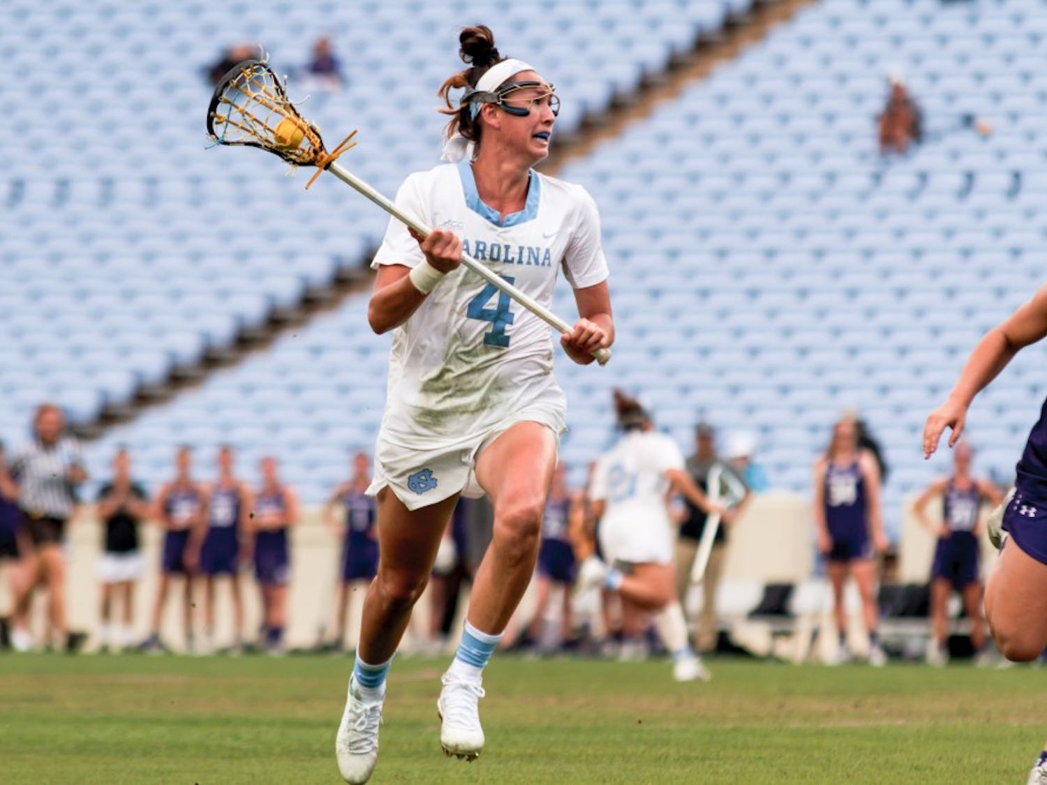 Carolina midfielder Marie McCool (4) carries the ball down the field during Saturday's NCAA quarterfinal win over Northwestern.