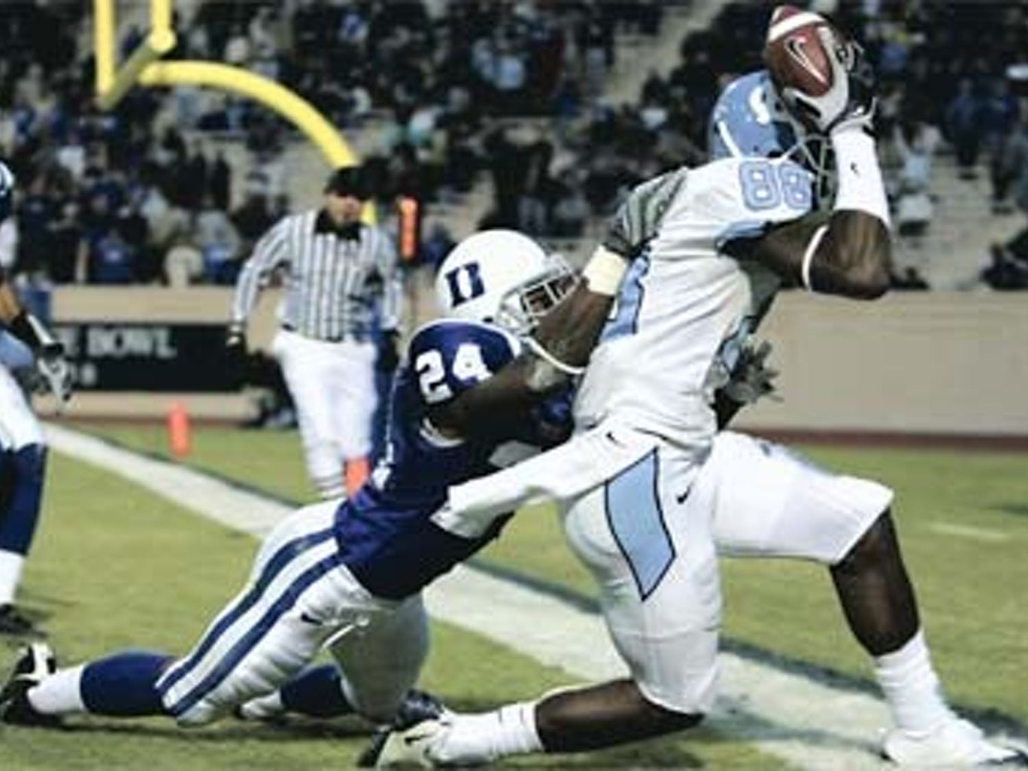 """Junior wideout Hakeem Nicks set the UNC single season record in receiving yards during Saturday?s game and finally hit his own personal goal of a 1""""000+ season. Nicks finishes with 1005 yards and nine touchdowns ? including this one Saturday caught against his helmet."""