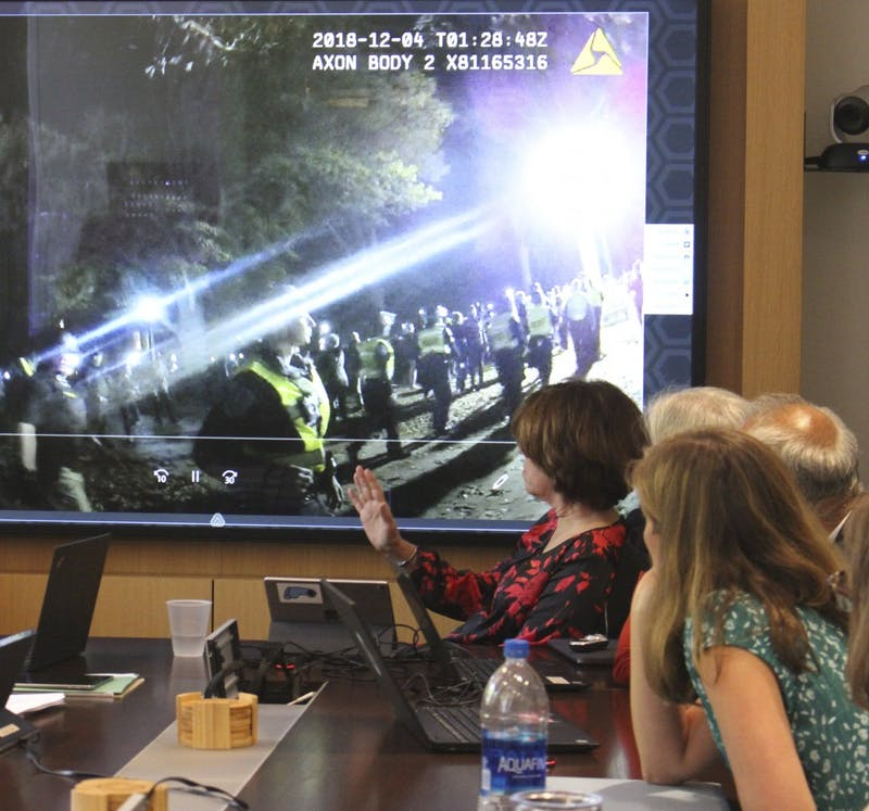 Mark Porlides, a UNC graduate student in the department of history, and anti-silent sam activist, shows the faculty executive committee body cam footage of his Dec 4, 2018 arrest while he was protesting Silent Sam at the committee's meeting on April 22, 2019. Porlides was showing the video in response to a memo written by history Professor Jay Smith regarding campus police conduct and student safety.