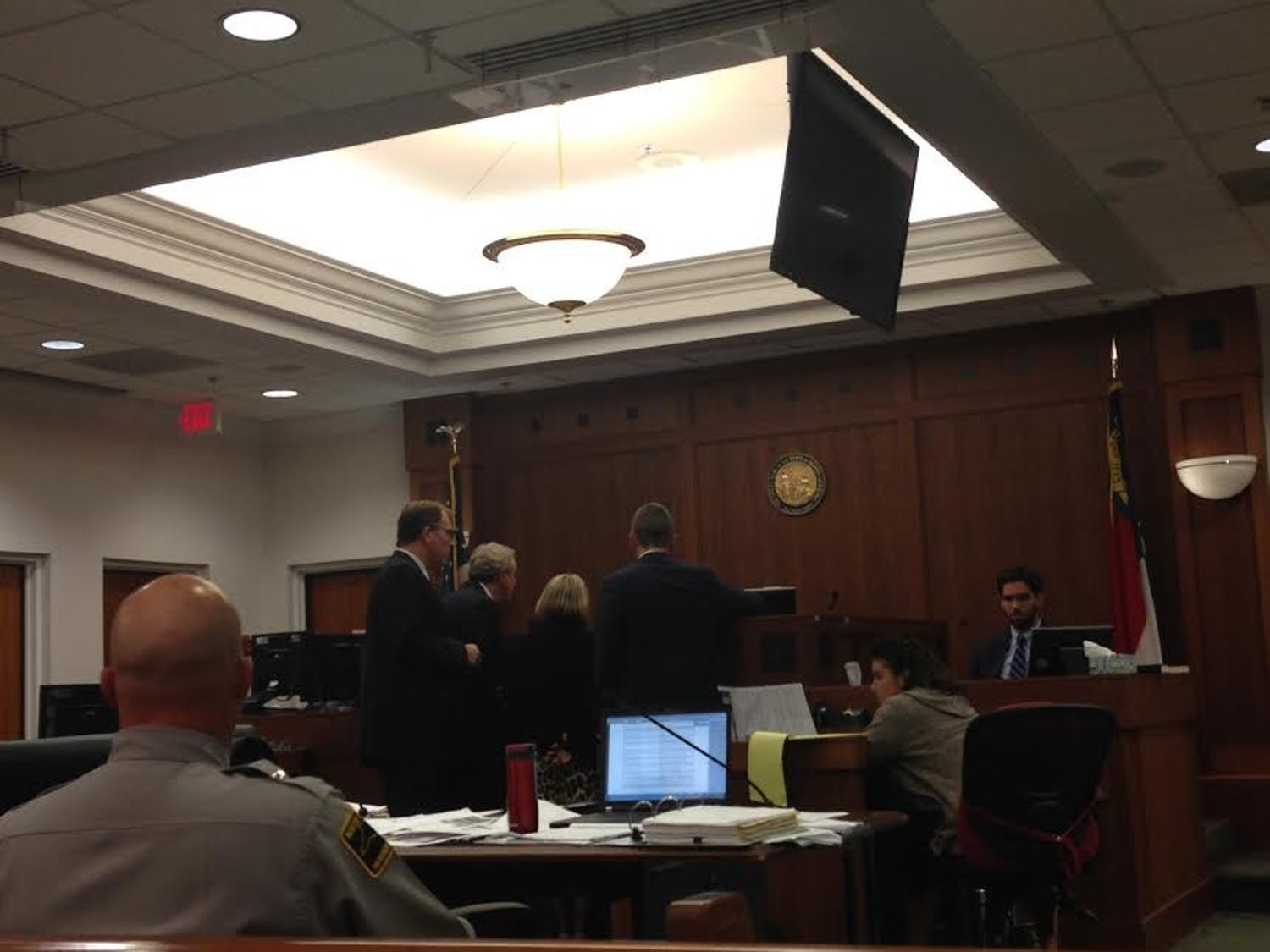 Prosecution and defense approach the bench during Chandler Kania's trial Friday.
