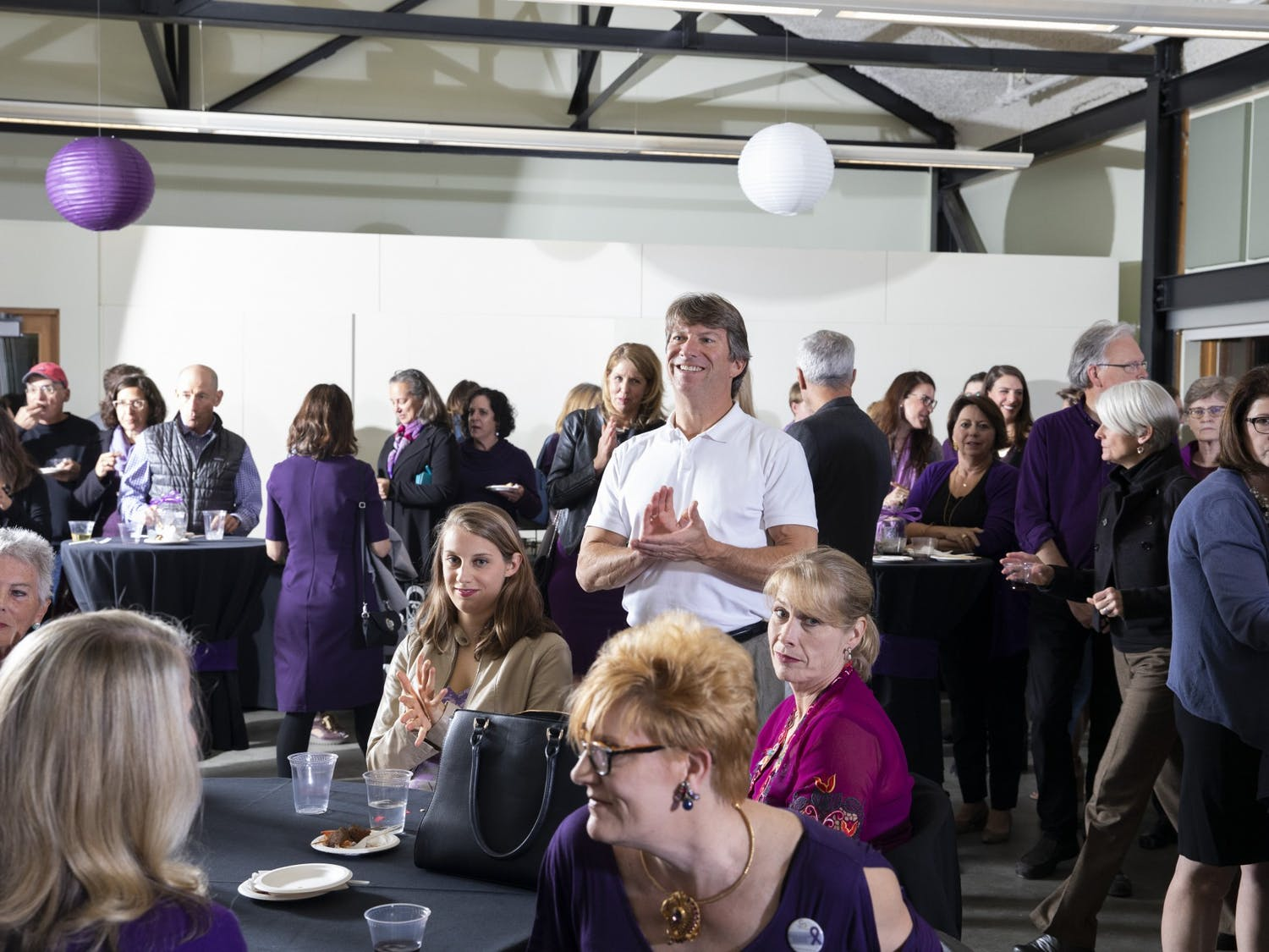 In fall 2019 the Compass Center held a fundraiser to rent apartments in Orange County to use as emergency housing for survivors of domestic violence and their children. Attendees wore purple in support of domestic violence awareness. Photo courtesy of Alex Lassiter/Copper Key Photo.