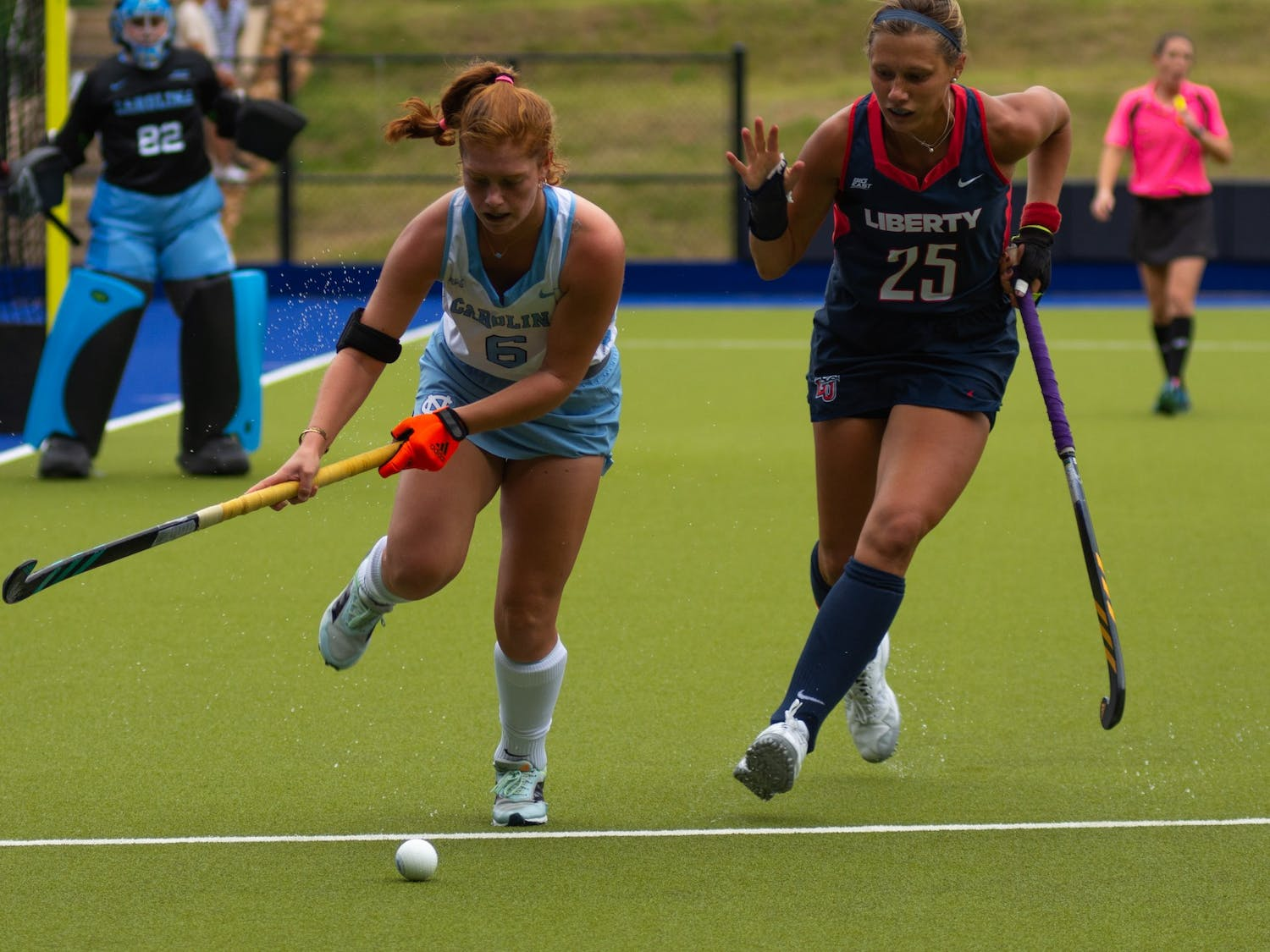Freshman back Kelly Smith (6) swipes the ball during UNC's Oct. 10 field hockey game against Liberty. The game proved to be a loss for the Tar Heels–Liberty headed home with a 4-0 win.