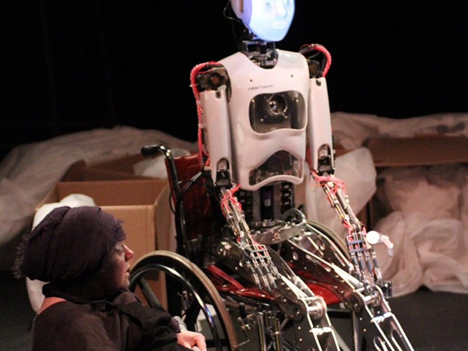 """Griffin Bernhard, Katja Hill, and RoboThespian act in the play """"The Uncanny Valley"""""""