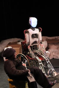 "Griffin Bernhard, Katja Hill, and RoboThespian act in the play ""The Uncanny Valley"""