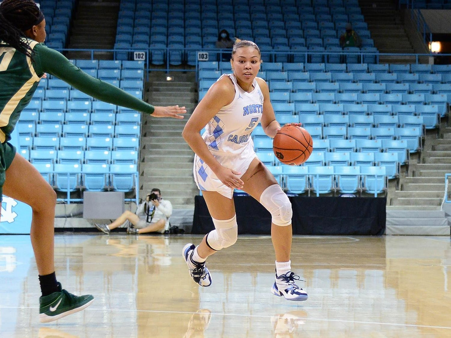 UNC graduate guard Stephanie Watts (5) avoids UNC Charlotte players during a game in Carmichael Arena on Sunday, Dec. 6, 2020. UNC beat UNCC 81-75. Photo courtesy of UNC Athletic Communications.