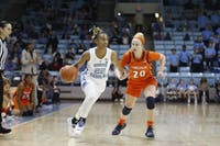 Redshirt senior guard Paris Kea (22) drives the ball during UNC's 70-53 win against Virginia at Carmichael Arena on Sunday, Feb. 17, 2019.