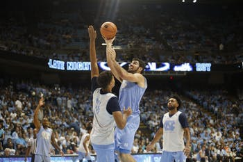 Forward Luke Maye (32) shoots a floater over teammate Cam Johnson (13) during UNC's Late Night With Roy scrimmage on Oct. 13.