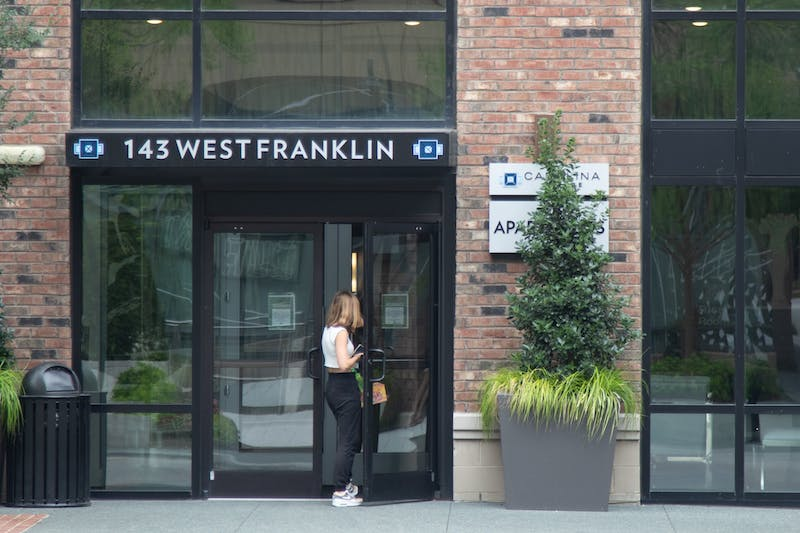 """A resident enters Carolina Square apartments on Thursday, Aug. 20, 2020. With classes moving online and on-campus housing """"de-densifying,"""" questions are being raised about how clusters in off-campus housing will be communicated to the UNC community."""