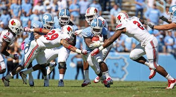 UNC tailback Giovani Bernard runs through the Louisville defense.