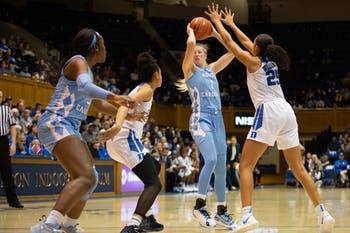 UNC senior guard Taylor Koenen (1) shoots while being defended by Duke  junior forward/center Jade Williams (25).  The Tar Heels lost to Duke 61-71 in Cameron Indoor Stadium on Thursday, Feb. 6, 2020.