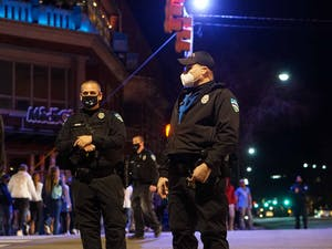 Chapel Hill police are stationed on Franklin Street during the UNC vs Duke basketball game on March 5, 2021. Police were present in an attempt to prevent students from rushing Franklin Street.