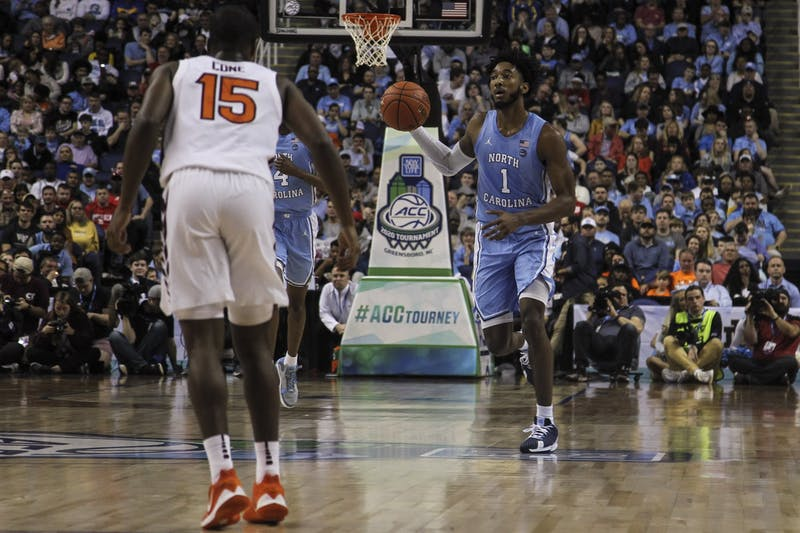 Sophomore guard Leaky Black (1) looks to pass during the first-round game of the ACC tournament against Virginia Tech in the Greensboro Coliseum Complex on Tuesday, March 10, 2020. UNC beat Virginia Tech 78-56.