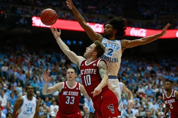 UNC first-year guard Coby White (2) attempts to block N.C. State sophomore guard Braxton Beverly (10) from scoring in the Smith Center on Tuesday, Feb. 5, 2019. UNC won 113-96. White scored 21 points during 27 minutes of play time.