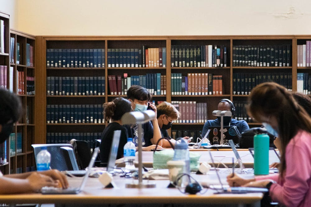 <p>Students congregate in Davis Library on Oct. 4, 2021. It was announced last week that University of North Carolina Libraries will undergo a $2 million budget cut this fiscal year and $3 million over the next. The proposed budget cut will reduce the purchase of new texts and journal subscriptions available to students.</p>