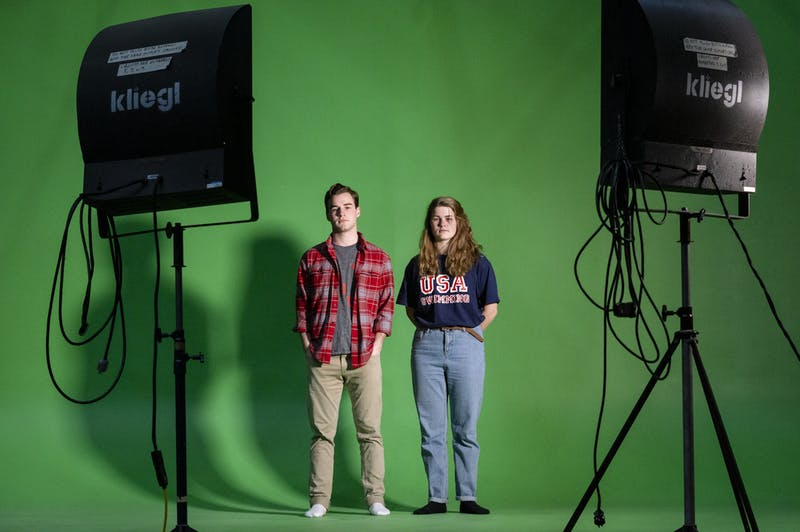 "(From left) Matthew Keith, communications and dramatic arts double major and Ellie Baker, English and communications double major, pose for a portrait at Swain studio in Swain Hall, Feb. 18, 2020. Keith and Baker both began the writing for the stage and screen minor at the same time in the fall of their junior year. ""It's allowed me to write with my peers in a writers room type setting, learning from each other while honing our skills specifically oriented to screen writing as opposed to creative writing classes that I've previously taken,"" Keith said. For Baker, the program was one she knew she wanted to do before she attended UNC. ""It teaches you to think of story actively and to always imagine your stories as something that is going to happen rather than something that could and it really pushes you to have a production minded drive with everything that you try to tell,"" Baker said. The minor is open to first-years and sophomores and the 2020 applications closes on March 2."